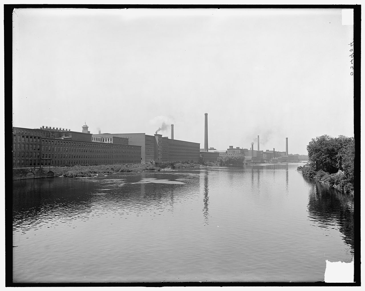 A view of the factories along the Merrimack River, around 1900.