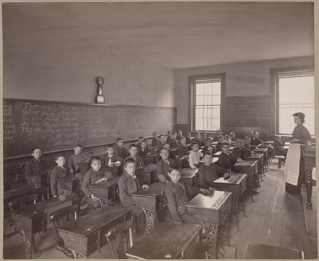 Immigrant children learning English in Boston schools, around 1890.